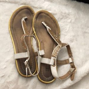 White and gold sandals